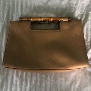 Bamboo handle clutch with optional strap